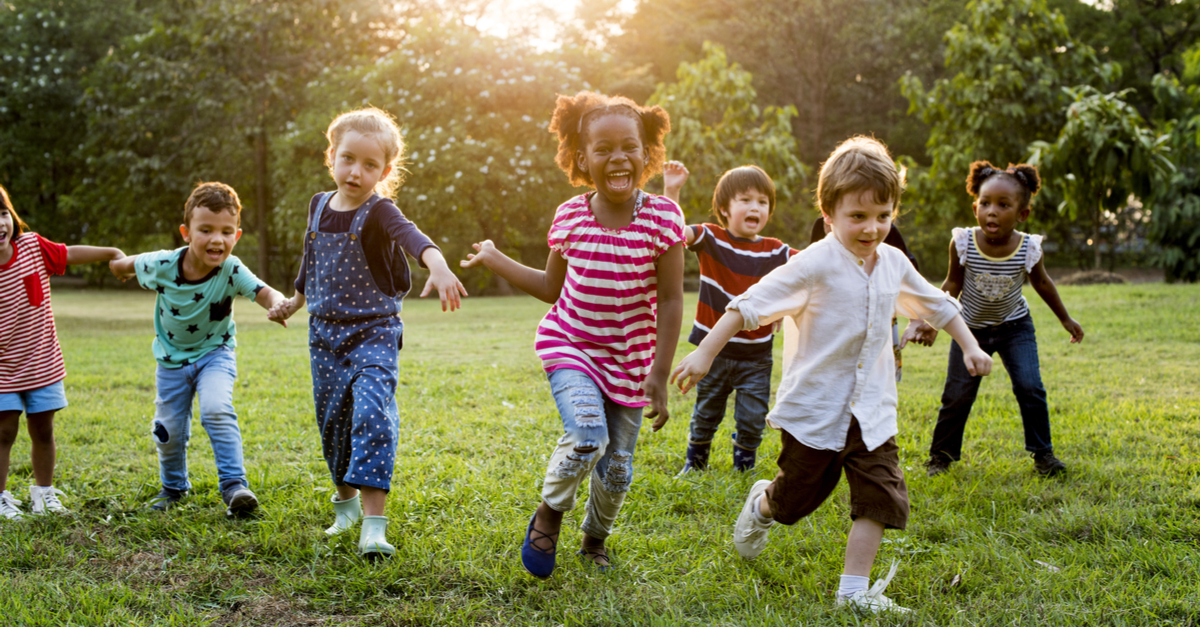 Happy children running in a park