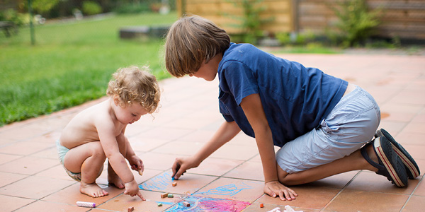 Two children playing in the backyard