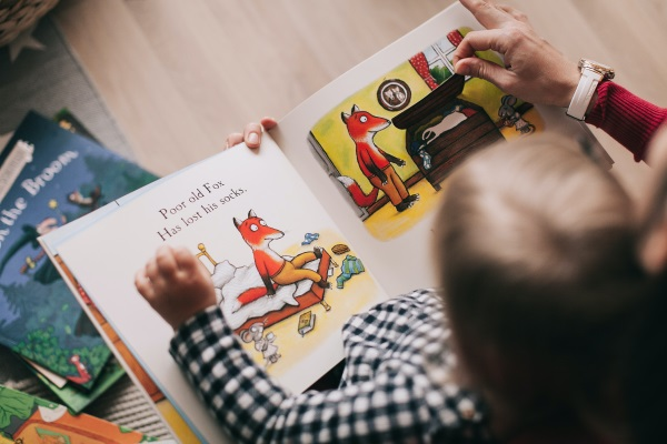 child reading a storybook