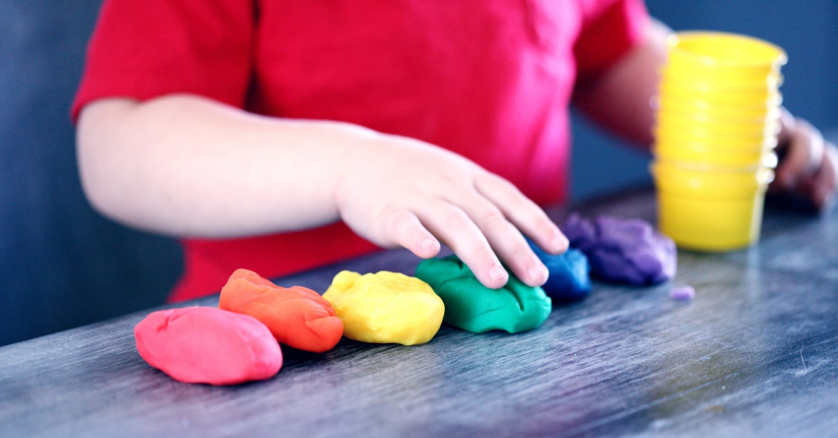 child with play dough