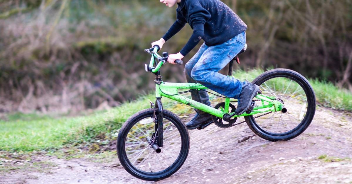 boy riding a bmx outdoors